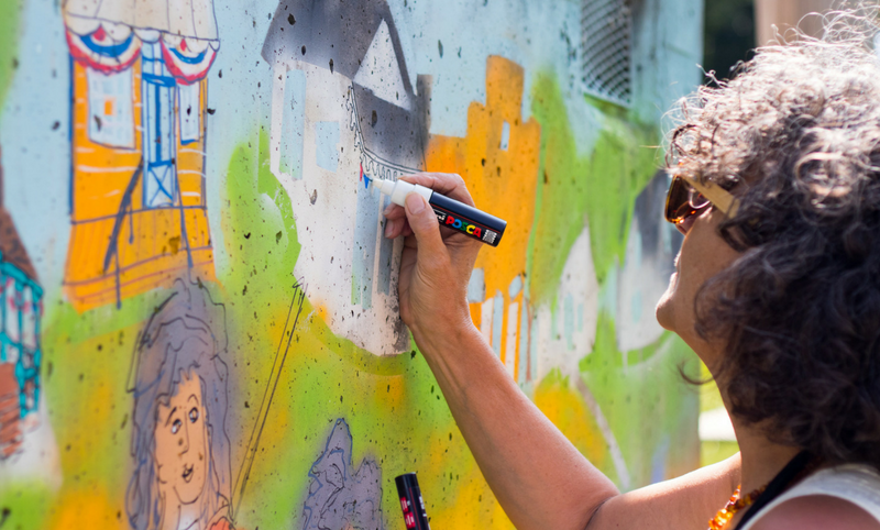 Woman painting a mural
