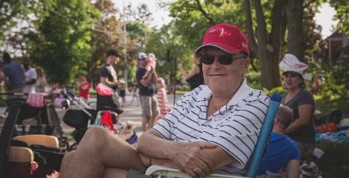 Man sitting on chair at Westmount street party